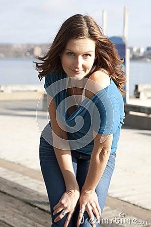 Model posing on waterfront
