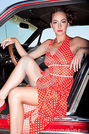 Model in red polka-dot dress