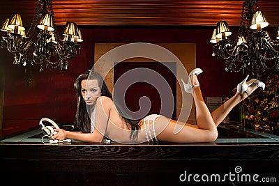 Model with retro headphones lying on bar