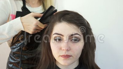 The model`s face Barber. Face model hairdresser close-up in the frame stock footage