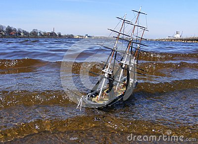 Model of sailing ship swimming in river