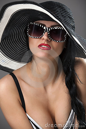 Model in striped hat and top with glassses