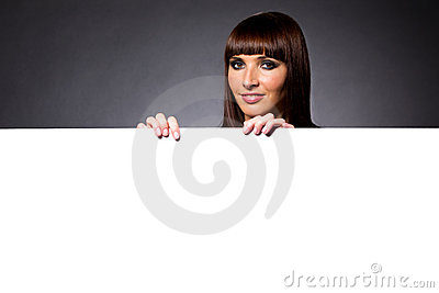 Model in Studio Behind Large Blank Sign