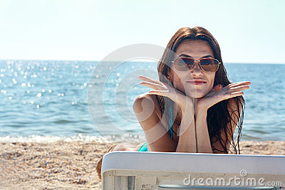 Model in swimsuit on the beach