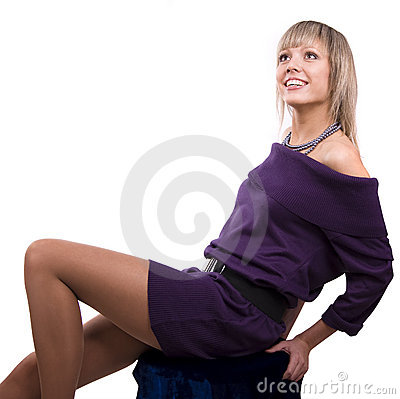 Model in violet dress is looking up