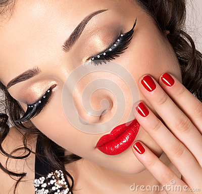 Free Model With Red Nails, Lips And Creative Eye Makeup Royalty Free Stock Image - 27862786