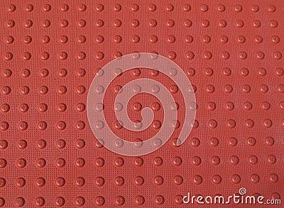 Modelo No-resbalado rojo en una acera