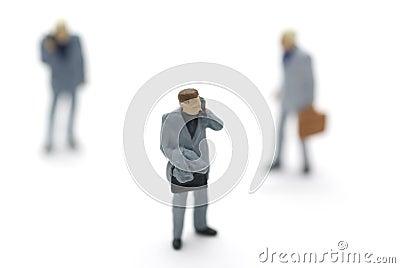 Models of three businessmen