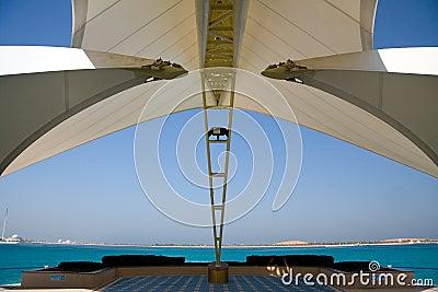Modern Abu Dhabi structure framing sea and island