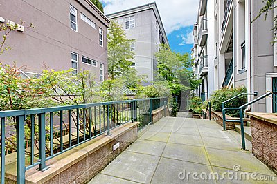 Modern apartment building with court walkway.