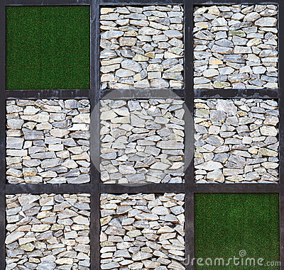 Modern art, block of rock wall and artificial gras