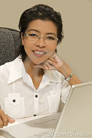 Modern Asian woman with computer