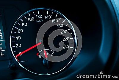 Modern automotive speedometer on black