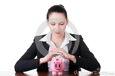 Modern bank model. Business woman sitting with piggy-bank.