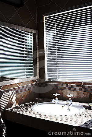 Modern bathroom with blinds on