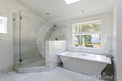 modern, marble tile bathroom with an open walk-in shower and bathtub ...