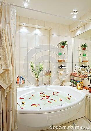 Modern bathroom in warm tones with jacuzzi