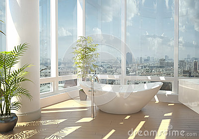 Modern bathtub against large windows
