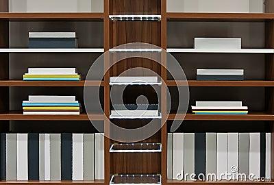 Modern books on bookshelf