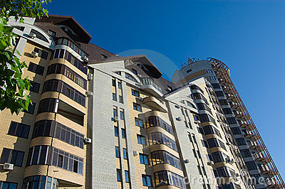 Modern brick multistory house on deep blue sky bac
