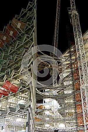 Modern building construction at night