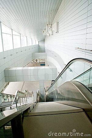 Modern building interior with escalator