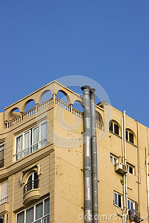 Modern building with smoke stacks