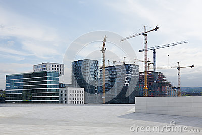 Modern buildings and cranes on duty