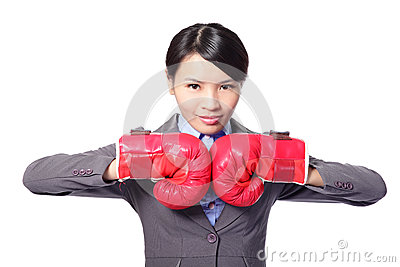 Modern business woman with boxing gloves