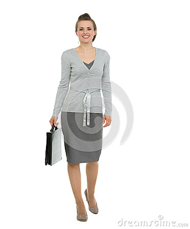 Modern business woman with briefcase making step f