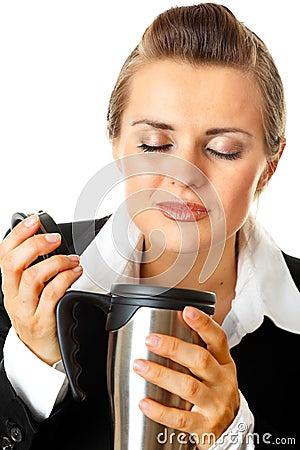 Modern business woman enjoying flavored coffee