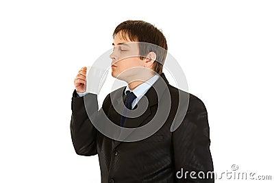 Modern businessman enjoying cup of flavored coffee