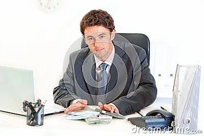 Modern businessman giving money packs