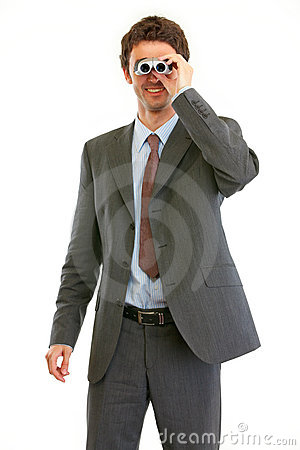 Modern businessman looking in binoculars