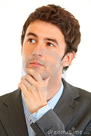 Modern businessman looking in corner at copy space