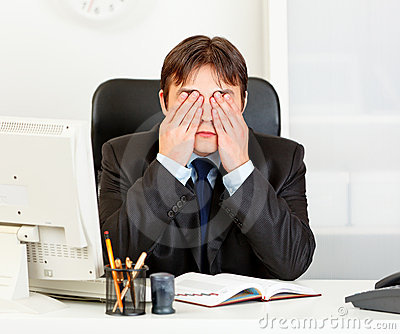Modern businessman making see no evil gesture