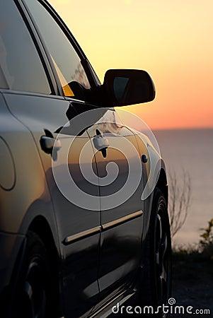 Modern car at sunset