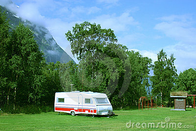 Modern caravan at the campsite in the mountains