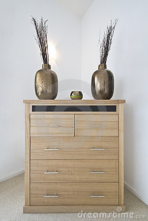 Modern chest of drawers with decorative vases