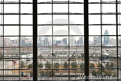 Modern cityscape behind window