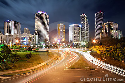Modern city at night with street lights
