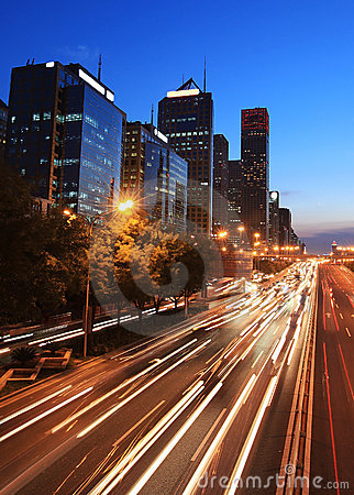 Modern city with traffic at dusk