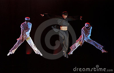Modern dancers perform on stage Editorial Stock Photo