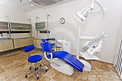 Modern dentist s chair in a medical room.