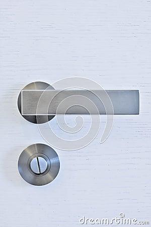Modern door handle on white door