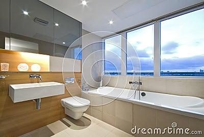 Modern en-suite bathroom with large window