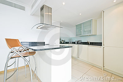 Modern fully fitted kitchen in vanilla white