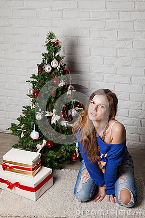 Modern girl near christmas tree