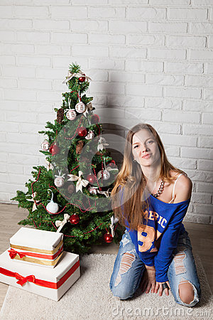 Modern girl near christmas tree