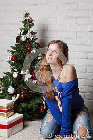 Modern girl near New Year s tree